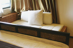Oriental style couch. Under window stock images