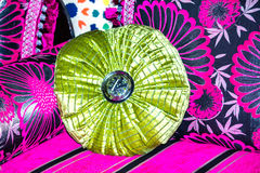 Oriental style – green pillow on colorful settee Stock Photos