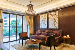 Oriental style luxury living room. Interior of  oriental style luxury living room in a chinese home  with french window Stock Photos