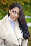 Oriental style. Sensual arabic woman model. Beautiful young girl in fur coat Stock Photography