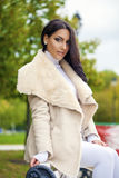 Oriental style. Sensual arabic woman model. Beautiful young girl in fur coat Royalty Free Stock Images