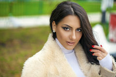 Oriental style. Sensual arabic woman model. Beautiful young girl in fur coat Stock Photo
