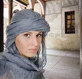 Oriental style woman in shawl. Portrait of a woman in an oriental style Royalty Free Stock Photo