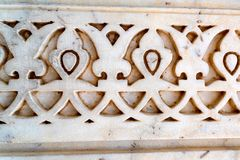 Indian wall pattern carved in stone. Oriental styled stone ornament carved in sandstone, India Royalty Free Stock Photos