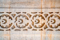 Indian wall pattern carved in stone. Oriental styled stone ornament carved in sandstone, India Royalty Free Stock Image