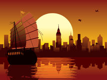 Oriental sunset. Vector illustration with panorama of oriental modern city and ancient ship sailing Royalty Free Stock Photography
