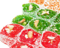 Oriental sweets. Colored oriental sweets on a white background royalty free stock photos