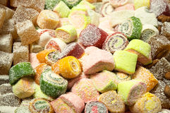 Oriental sweets. A variety of oriental sweets with coconut Stock Images