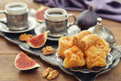 Oriental sweets with coffee Stock Photos