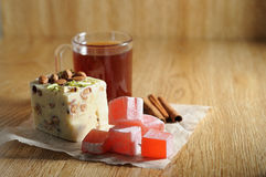 The oriental sweets. And cups of tea Royalty Free Stock Photos