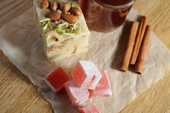 The oriental sweets. And cups of tea Stock Images