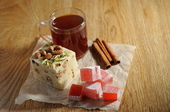 The oriental sweets. And cups of tea Royalty Free Stock Images