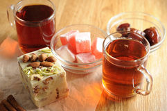 The oriental sweets. And cups of tea Stock Image