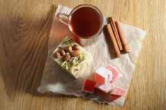 The oriental sweets. And cups of tea Stock Photo