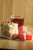 The oriental sweets. And cups of tea Royalty Free Stock Photography