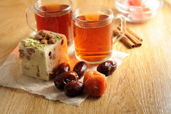 The oriental sweets. And cups of tea Royalty Free Stock Image