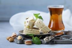 Halva with pistachios. Oriental sweets - halva with pistachios royalty free stock photo