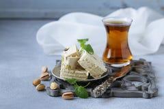 Halva with pistachios. Oriental sweets - halva with pistachios stock photo