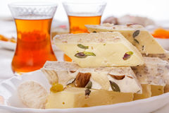 Oriental sweets halva and tea. Soft light. High key Royalty Free Stock Photos
