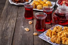 Oriental sweets with hibiscus tea. Stock Image