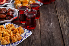 Oriental sweets with hibiscus tea. Stock Photos