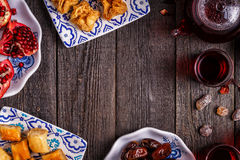 Oriental sweets with hibiscus tea. Stock Images