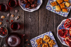 Oriental sweets with hibiscus tea. Royalty Free Stock Image