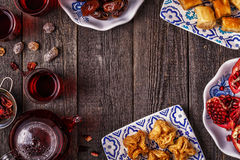 Oriental sweets with hibiscus tea. Royalty Free Stock Photography