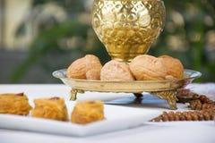 Oriental Sweets. Kunafa and Walnuts royalty free stock photo