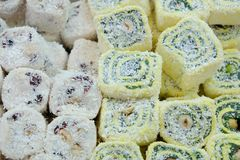 Oriental sweets in the local market, rahat loachum on the table. Closeup photo Royalty Free Stock Images