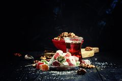 Oriental sweets with nuts and black tea, selective focus. Food still life stock images
