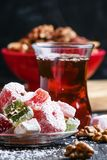 Oriental sweets with nuts and black tea, selective focus. Food still life royalty free stock photos