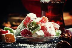 Oriental sweets with nuts and black tea, selective focus. Food still life stock image