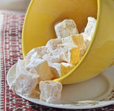 Oriental sweets. In powdered sugar saucer on the table Stock Images