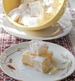 Oriental sweets. In powdered sugar saucer on the table Royalty Free Stock Image