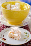 Oriental sweets. In powdered sugar saucer on the table Royalty Free Stock Photo