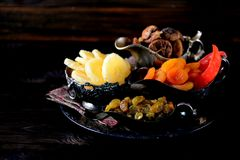 Oriental sweets raisins, dried apricots, figs and cashew nuts. Stock Photo