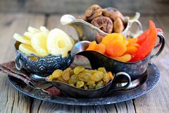 Oriental sweets raisins, dried apricots, figs and cashew nuts. Royalty Free Stock Image