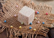 Oriental sweets from sesame. On an old wooden background royalty free stock image