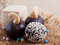 Oriental sweets from sesame. On an old background of cloth royalty free stock photos