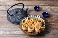 Oriental sweets, teapot and two bowls Royalty Free Stock Photography