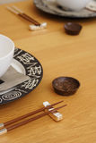 Oriental table setting. Table set for oriental meal, with chopsticks and rice bowls Stock Images