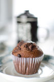 Oriental Tea with chocolate muffins. On elegant porcelain dish Royalty Free Stock Photo