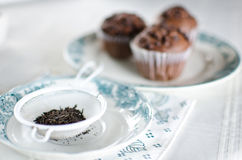 Oriental Tea with chocolate muffins. On elegant porcelain dish Royalty Free Stock Image