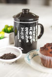 Oriental Tea with chocolate muffins. On elegant porcelain dish Royalty Free Stock Images