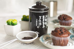 Oriental Tea with chocolate muffins. On elegant porcelain dish Royalty Free Stock Photography