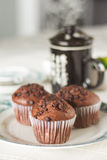 Oriental Tea with chocolate muffins. On elegant porcelain dish Stock Photos