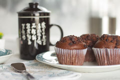 Oriental Tea with chocolate muffins. On elegant porcelain dish Stock Photo