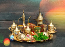 Oriental tea coffee golden dishes delight mint vintage Royalty Free Stock Image