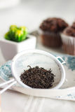 Oriental Tea leaves with chocolate muffins. Oriental Tea with chocolate muffins Royalty Free Stock Photography